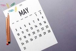 May 2020 simple calendar with office supplies and copy space