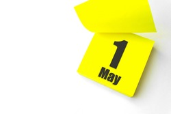 May 1st . Day 1 of month, Calendar date. Close-Up Blank Yellow paper reminder sticky note on White Background. Spring month, day of the year concept