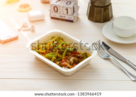May 1st. Image of may 1, food in a container food delivery and calendar May 1 on the table. International Workers' Day