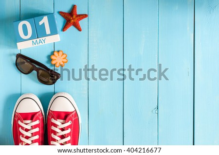 May 1st. Image of may 1 wooden color calendar on blue background.  Spring day, empty space for text.  International Workers' Day #404216677