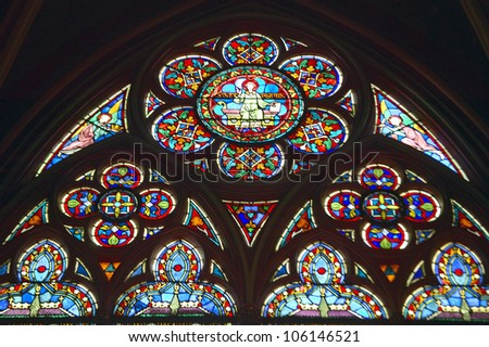 MAY 2004 - Stained glass windows inside the Notre Dame Cathedral, Paris, France