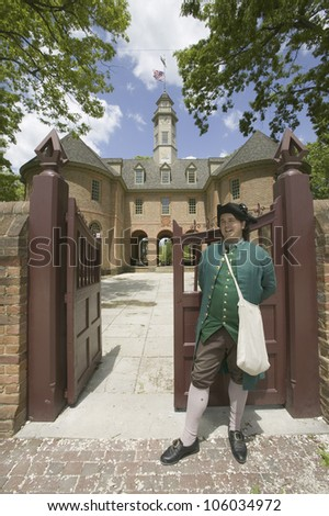 MAY 2007 - 18th Century reenactor standing at front gate of the Capitol Building of Colonial Williamsburg, Virginia. - stock photo