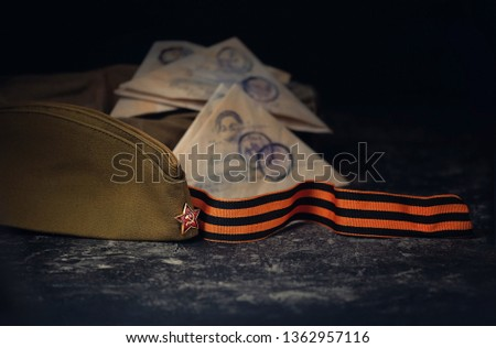 May 9 victory day holiday background. ribbon of St. George, military cap, old soldier's war letter. symbol of Victory Day 1945. copy space