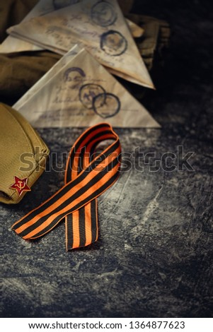 May 9 victory day holiday background. ribbon of St. George, symbol of may 9, Victory day, soldier's war letter, military cap. celebration of Victory Day 1945. copy space