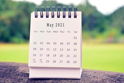 May 2021 white calendar with green blurred background. 2021 new year concept