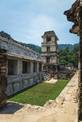 Maya temple ruins with palace patio and observation tower in tropical forest, Palanque, Chiapas, Mexico