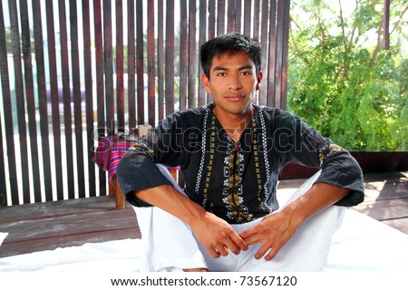 Mayan indian native man in jungle Latin American hut portrait
