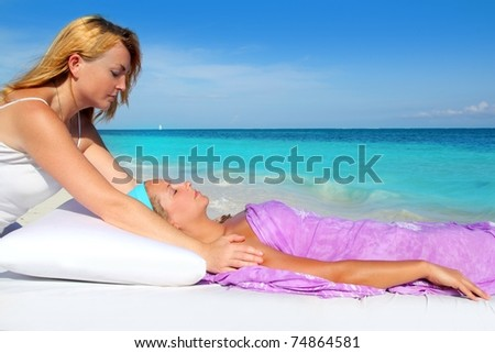 Mayan reiki massage in Caribbean beach woman vacation therapy - stock photo