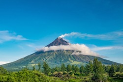 Mayon Volcano is an active stratovolcano in the province of Albay in Bicol Region, on the island of Luzon in the Philippines. Renowned as the