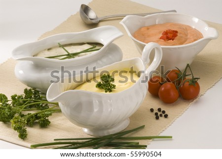 Mayonnaise cheese and cocktail sauces in sauce-boats. Salad dressing.
