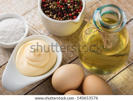 Mayonnaise in bowl  on table. Ingredients for mayonnaise. Selective focus.