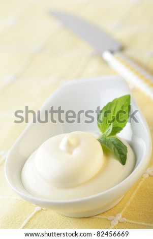 Mayonnaise with basil leaf in the sauce bowl