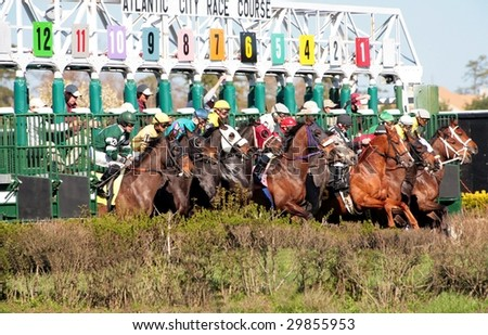 MAYS LANDING, NJ - APRIL 16: Jockeys with horses come out of the gate April 16, 2009 in Mays Landing, NJ. Atlantic City Race Coarse in their first day of live racing of the season. - stock photo