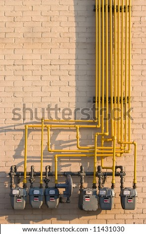 Maze of pipes and natural gas meters. Concept for raising energy or utility costs, environmental concerns or advantages of alternative heating methods.