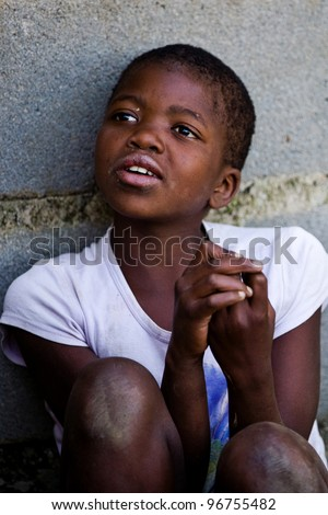 MBABANE, SWAZILAND- JULY 30: Portrait of unidentified Swazi girl on July 30, 2008 in Mbabane, Swaziland. Close to 10 percent of Swaziland's total population are orphans, due to HIV/AIDS.