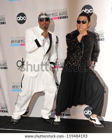 MC Hammer & Psy (right) at the 40th Anniversary American Music Awards at the Nokia Theatre L.A. Live. November 18, 2012  Los Angeles, CA Picture: Paul Smith