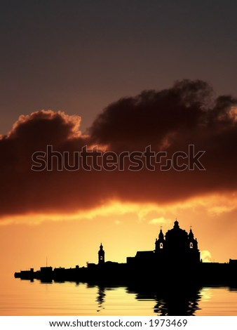 Mdina, medieval silent city of Malta, silhouetted against sky at dusk