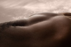 Meadow. Detailed texture of human skin. Close up of young african-american male body surface like landscape with the sky on background. Skincare, bodycare, healthcare, inspiration, fantasy artwork.
