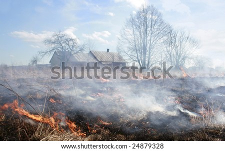 meadow fire sends out large smoke clouds after burning a grass wastelands, natural disaster, clouds of smoke