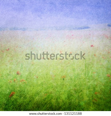 Meadow flowers / Grunge spring background with poppies on a field. Pastel, painterly feel. Faded central area for copy space.