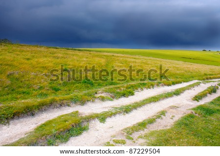 Meadow path before thunder storm
