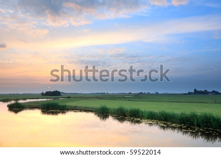 Meadow with canal at sunrise, the Netherlands