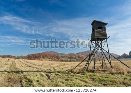 Meadow with deer-stand   with blue sky