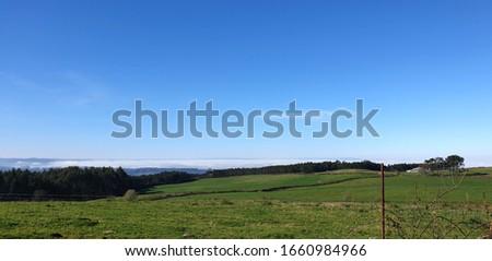 Meadows and rural Galician countryside at dawn, Paderne, Galicia by Fermín Tamames Stok fotoğraf ©