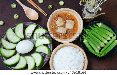 Meal for vegetarian with menu: bottle gourd, okra, egg, cooked rice, soya cheese. This Vietnamese food very delicious, nutrition, cholestorol free with organic, cheap ingredient and  for diet people