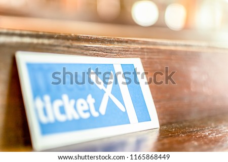 Meal Ticket, Food Ticket, isolated. Concept of exploitation, income or success. Join line at bank/ homeless shelter/ government assistance/ welfare. Feed poor/ marginalized people in need/ lack help. Stock photo ©
