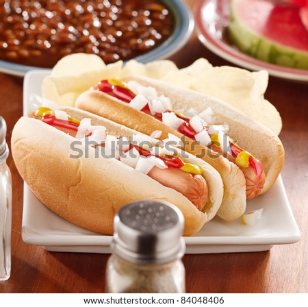 meal with hot dogs and toppings
