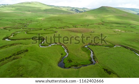 Meandering stream with mountains and clouds at The Persembe Plateau at Ordu, Turkey Stok fotoğraf ©