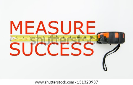 Measure of success conceptual using measuring tape