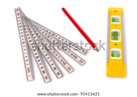 measure, pencil and bubble level isolated on white