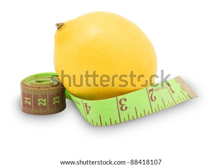 Measure tape and a lemon, diet concept
