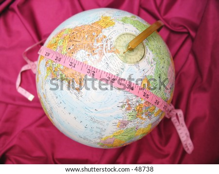 Measure tape over a globe.