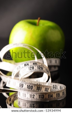 measure (tapeline) and apple