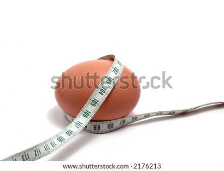 Measurement tape wrapped around the egg, nutrition concept