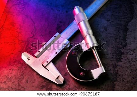 stock-photo-measurement-tools-calipers-micrometer-caliper-90675187.jpg