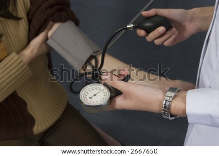 measuring blood pressure on young women