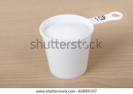 measuring cup with one cup of sugar stock photo 60889507
