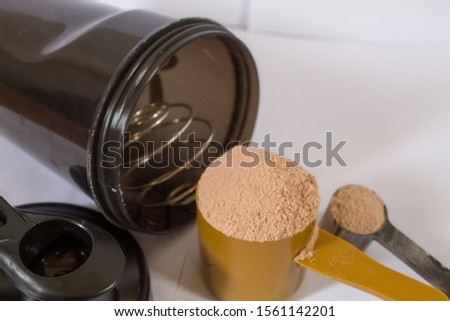 measuring scoop of whey protein powder isolated on background