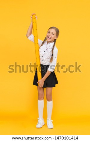 Measuring skills. Measuring height. Measuring equipment. Kid cute student study math. Knowledge day. Schoolgirl school uniform hold big ruler. Geometry school lesson. One meter hundred centimeters.