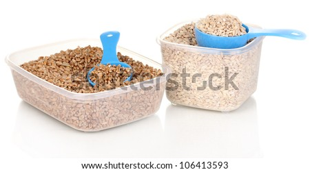 Measuring spoons and plastic containers with grain isolated on white