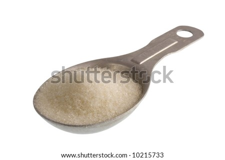 measuring tablespoon of white sugar isolated on white, clipping path included