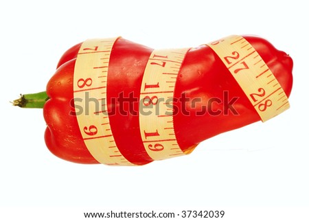 Measuring tape and sweet pepper on a white background