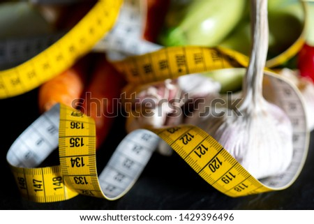 Measuring tape for measuring the circumference. Vegetables for diet cooking.