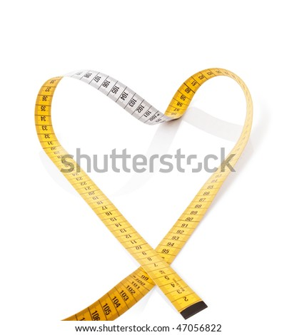 Measuring tape makes heart on a white background - stock photo