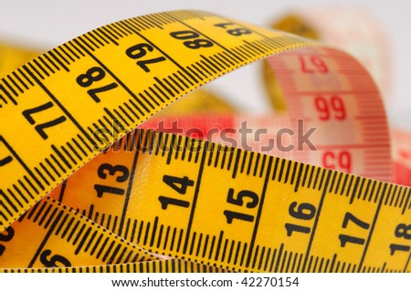 Measuring tape of the tailor. Shallow DOF. Close-up.