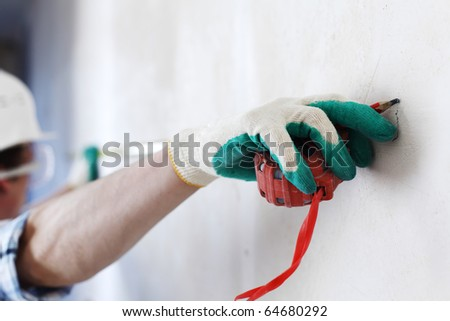 measuring tape on the wall